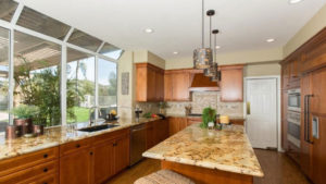Large Kitchen Island, Brown Cabinets, Large Kitchen Windows
