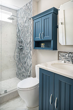 blue and white hall bathroom with tile mosaic