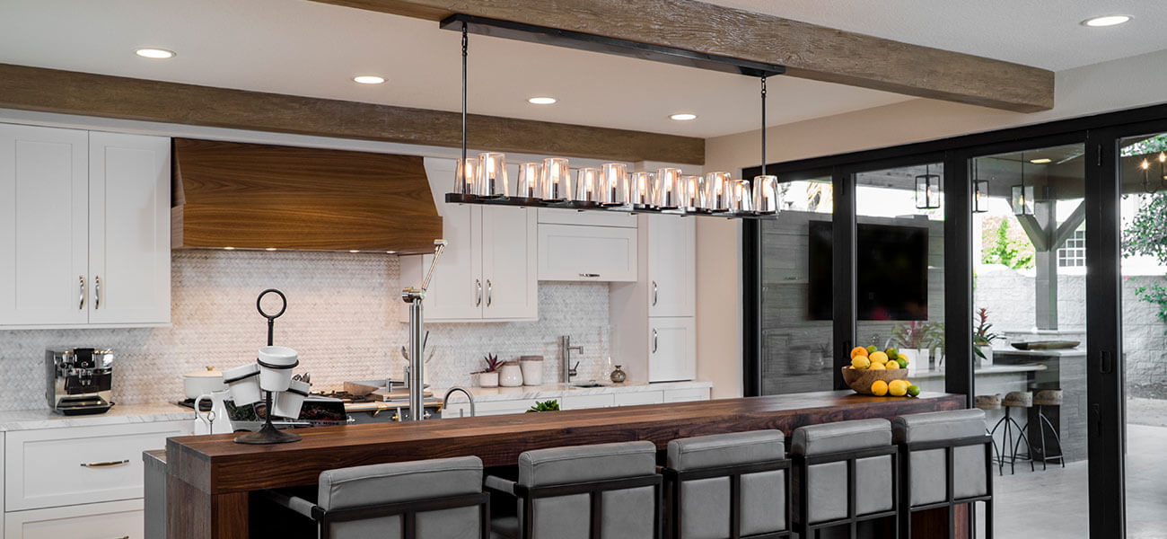 kitchen island with wood surface and white cabinets