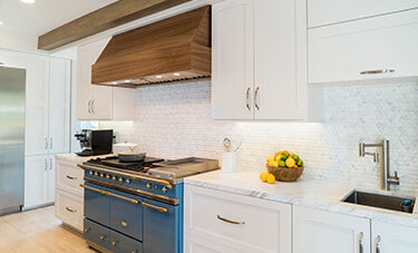 white kitchen cabinets with bright blue oven range