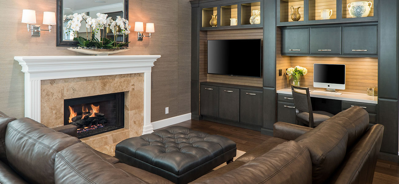 built in family room media center with desk seating and storage