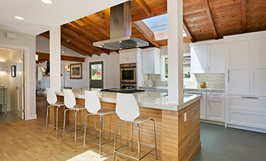 large kitchen with open floor plan and island seating for four
