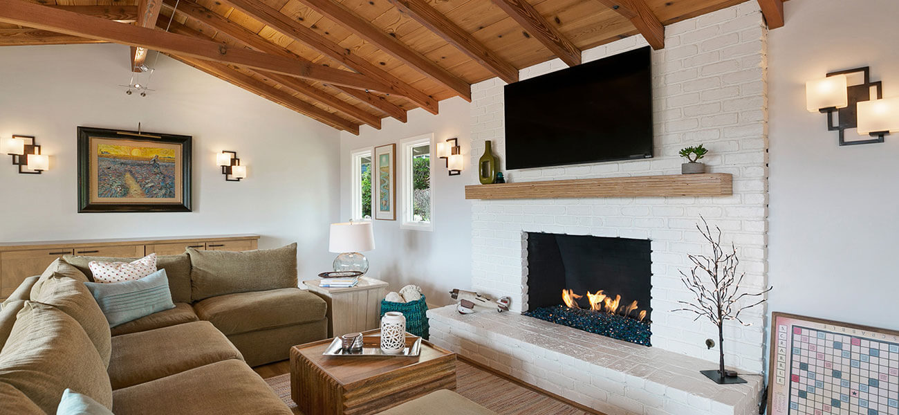 large family room with whitewashed brick fireplace