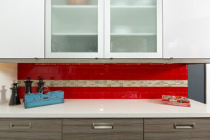 Red Subway Tile With Custom Cabinets with Glass Windows