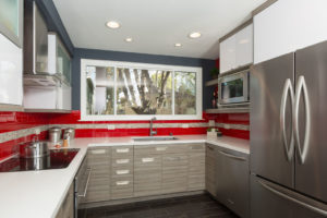 Modern Style Kitchen with Red Subway Backsplash and White Counters