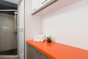 Modern Master Bathroom with Orange Counter