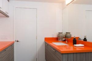 Modern Master Bathroom Design with Orange Counter