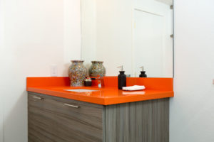 Modern Bathroom Design Using Rust Colored Counter