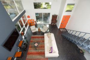 Modern Living Area Deisgn Using Orange and Gray Tones
