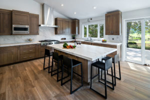 kitchen with all white counter and backsplash and wooden cabinets