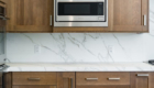Carrera Marble Backsplash, Carrera Marble Countertop, Carrera Marble and Wood Cabinets
