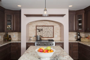 Creme Colored Countertop and Backsplash in Kitchen Remodel