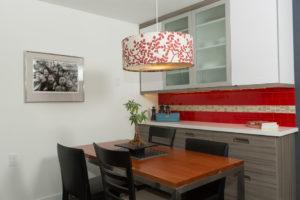 Red Subway Glass Tile Backsplash with Custom Cabinets for Stoage