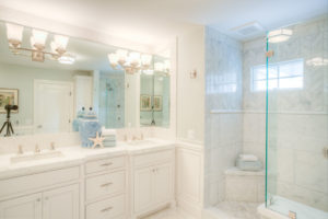 White and Blue Bathroom Design with His and Her Sinks