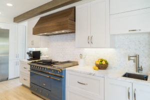 White Kitchen counter and cabinets with blue range