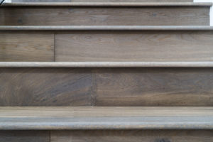 Tile wood floors on a staircase