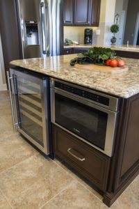 Dark Wood Kitchen Island With pullout microwave and drink fridge