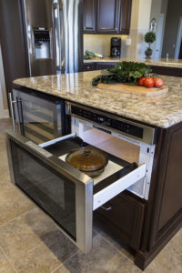 kitchen island with pullout microwave and wine fridge