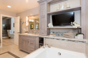 Master Bathroom With Custom Cabinets and TV
