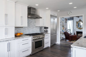 all white kitchen cabinetry with minimalist hardware