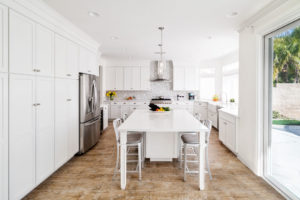 large white kitchen with kitchen island/table