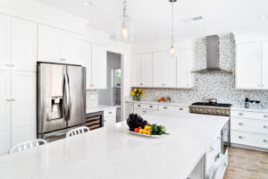 white kitchen with stainless steel appliances and blue accents