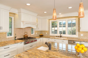 kitchen design with gold and white features