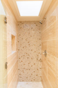 Large Walk In Shower with Sky Light and Natural Stone