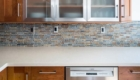 Custom Backsplash, White Counter tops, Custom Kitchen Cabinets, Glass Cabinets