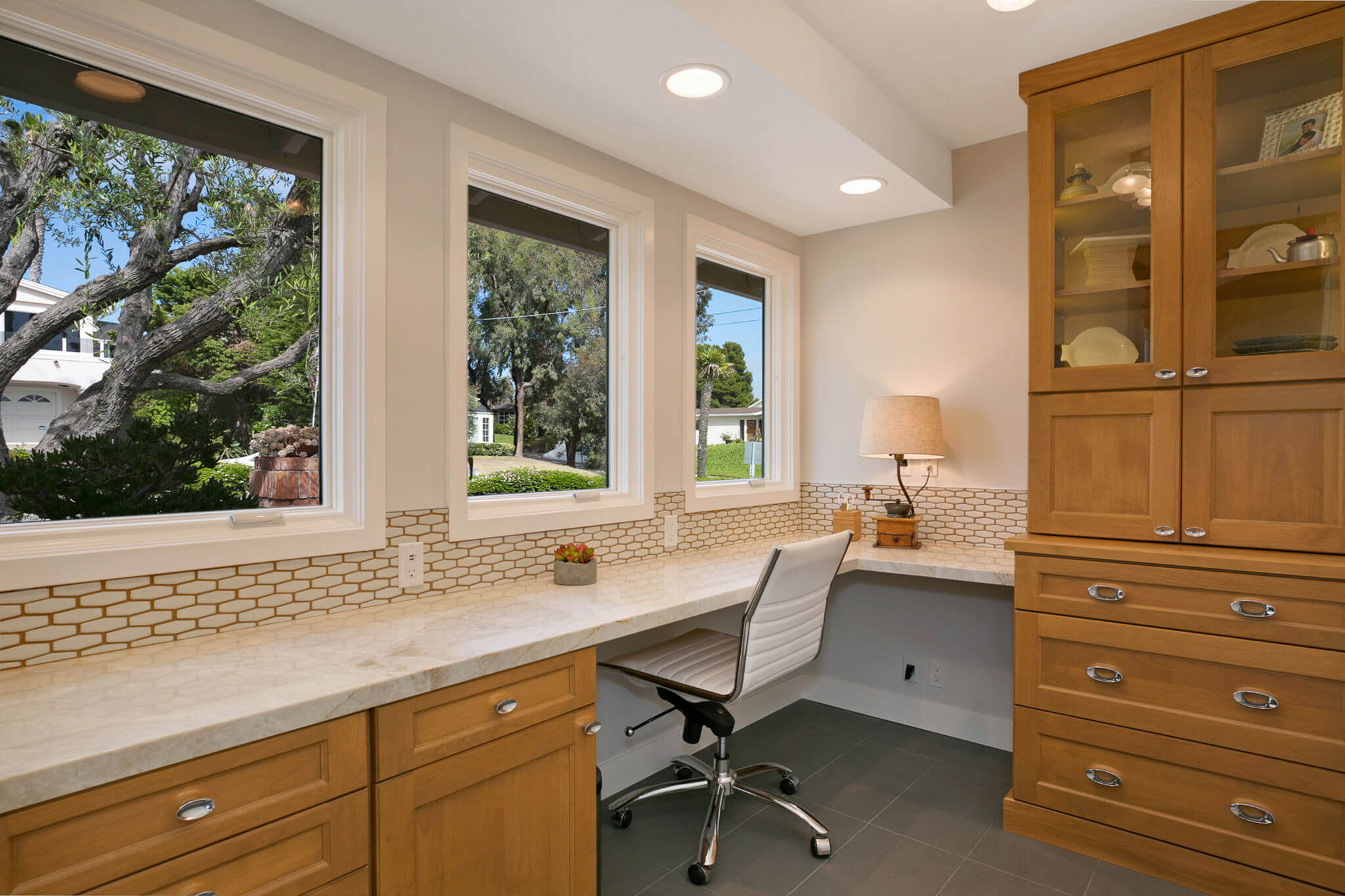 home office with custom cabinets and quartzite counter tops