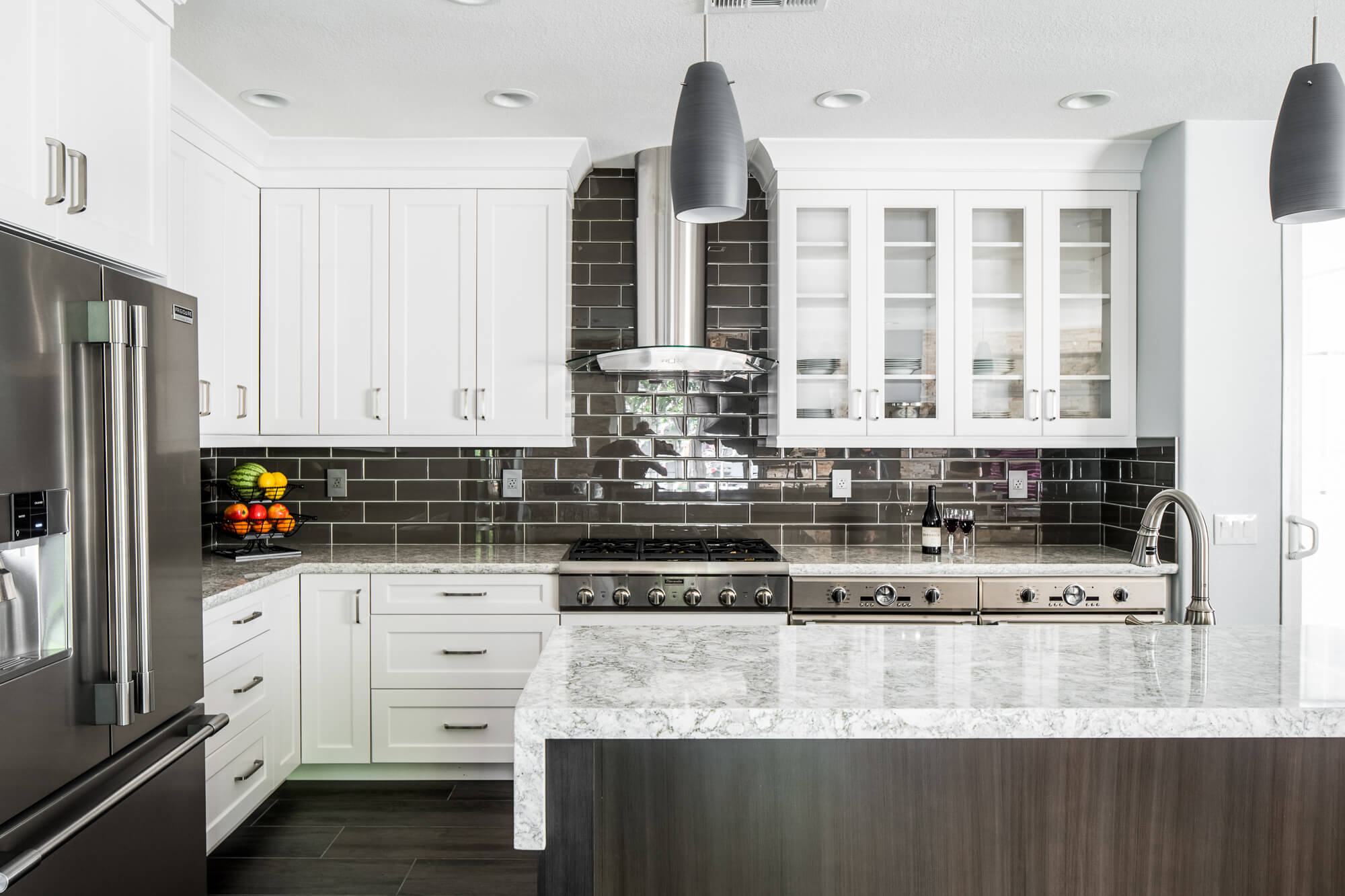 gray and white kitchen and subway style backsplash and quartz countertop