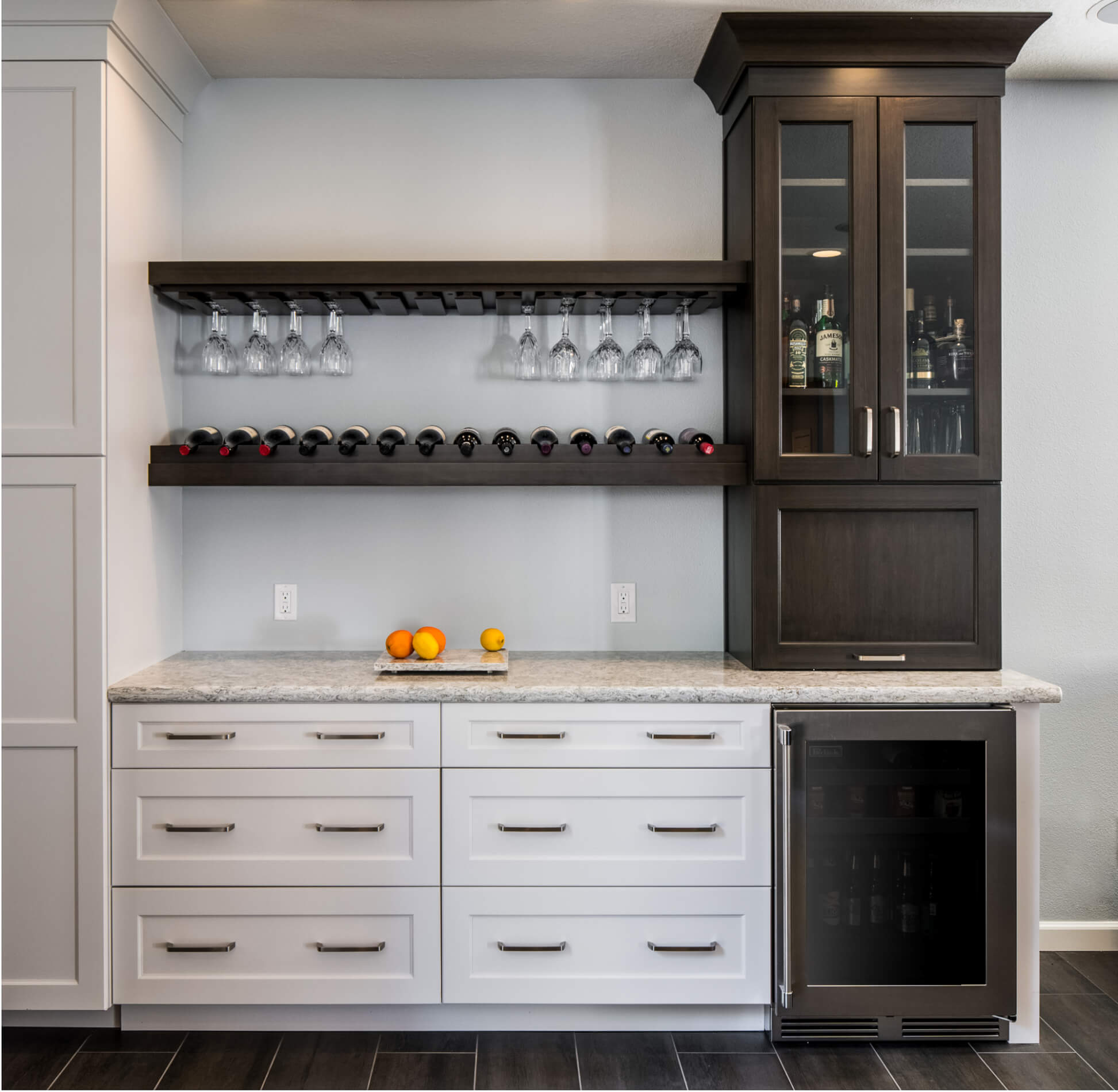 bar area in kitchen with builtin mini fridge winerack and hutch storage