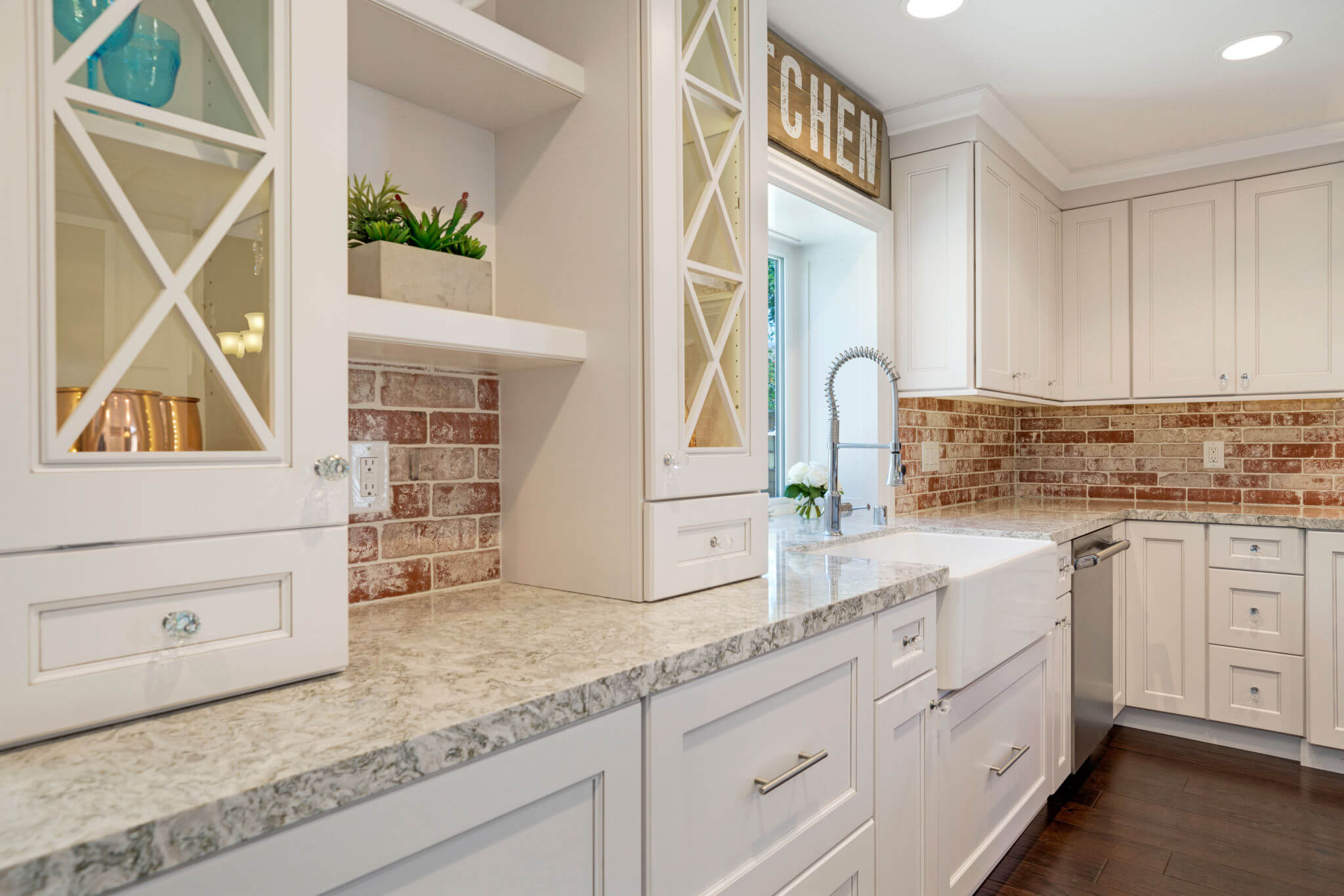 white gray and red kitchen with lots of cabinet storage