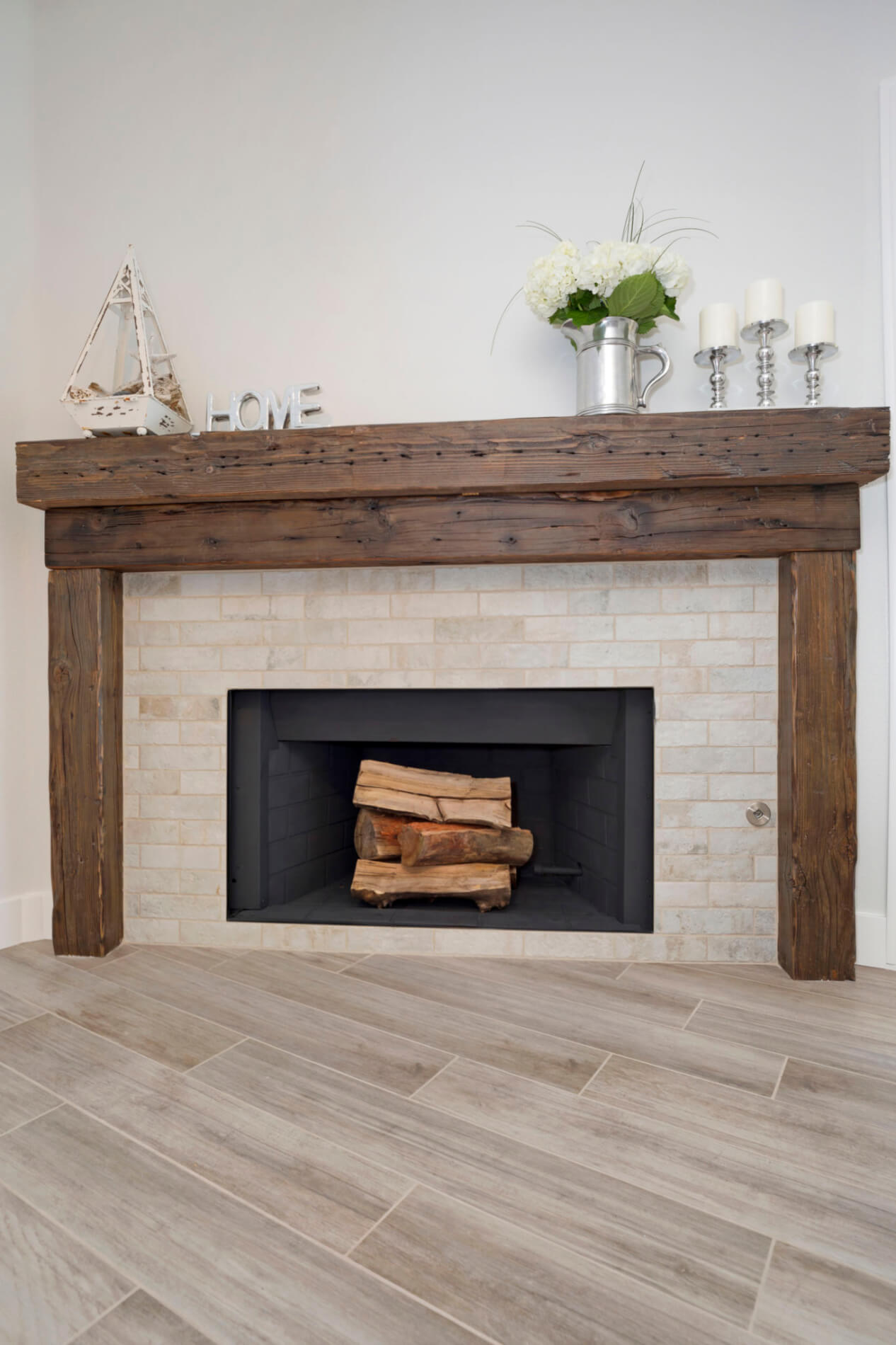 large reclaimed wood fireplace with subway style stone detail