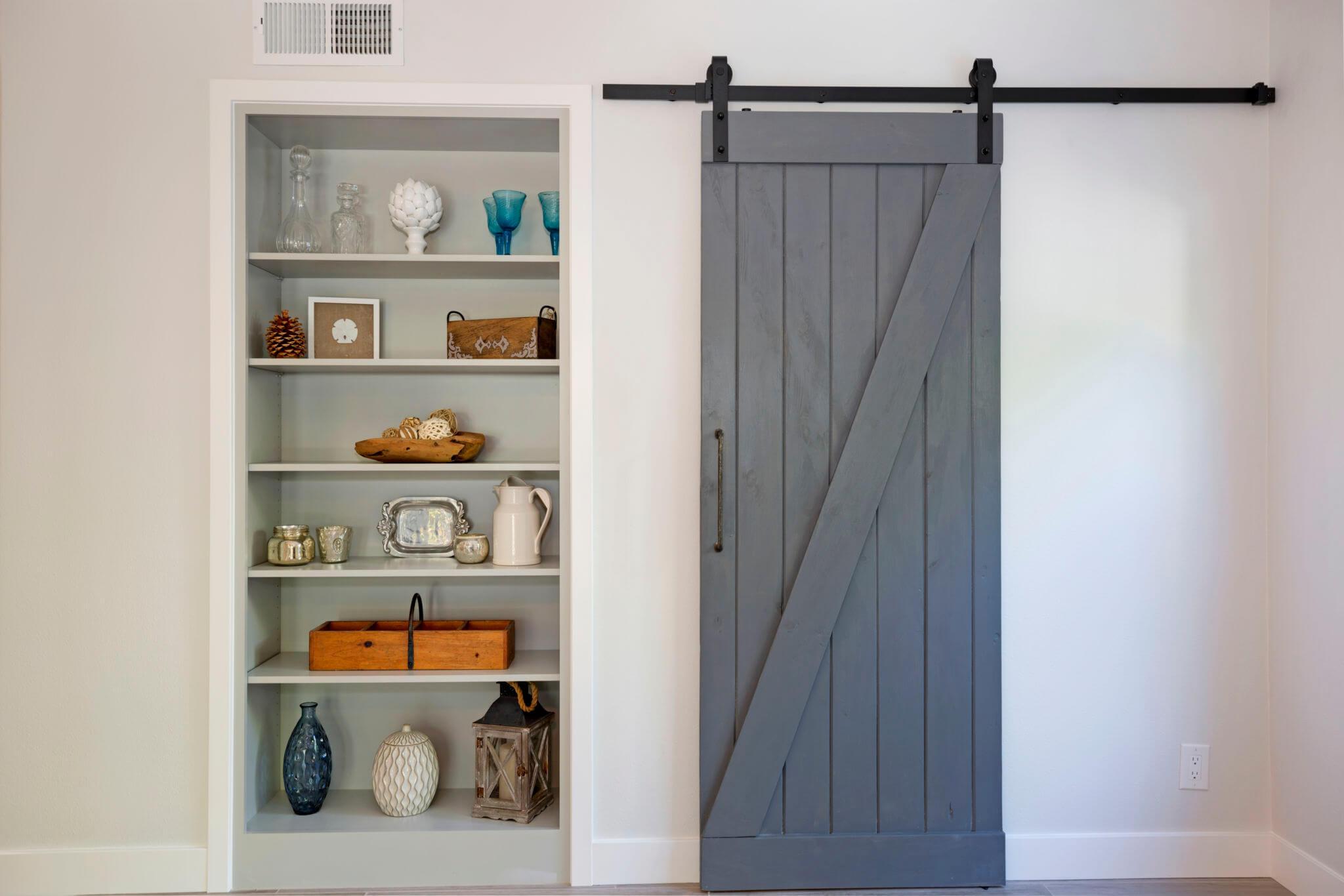 Living Space Barn Door, Barn Door in Remodeled Living Room, Remodeled Laundry Room with Barn Door