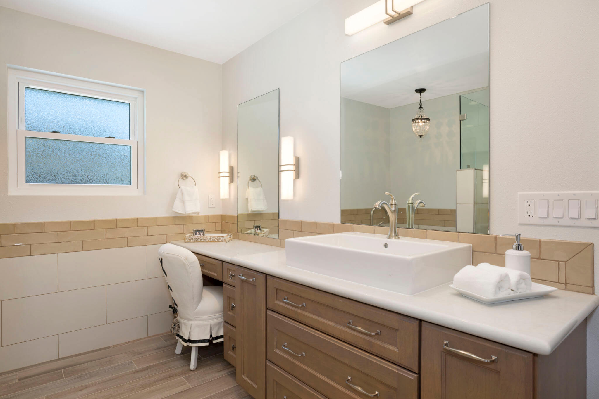 brown and white master bathroom vanity with a single sink