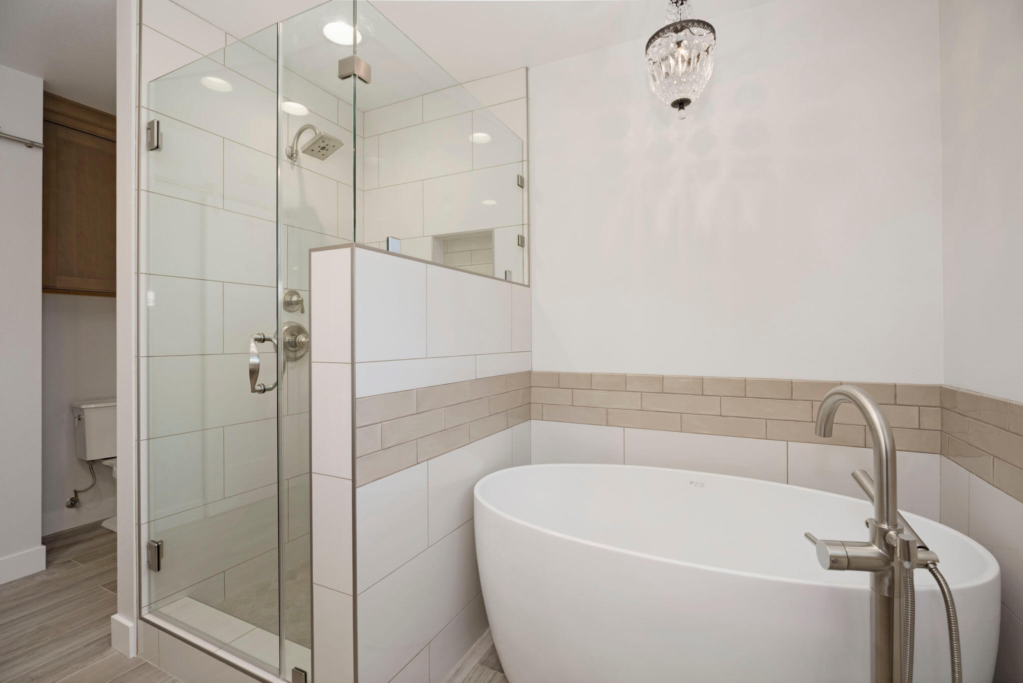 freestanding bathtub in small master bathroom