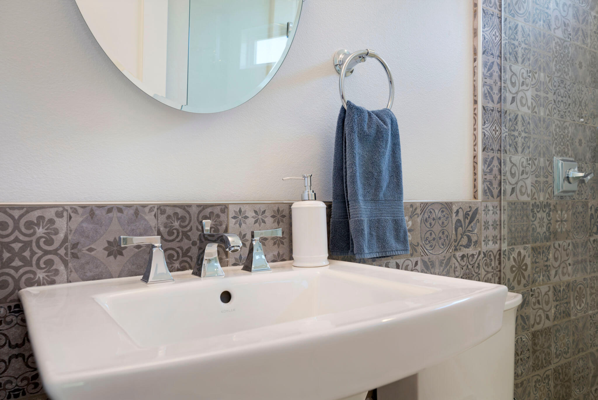 concrete looking Spanish style tile in bathroom remodel