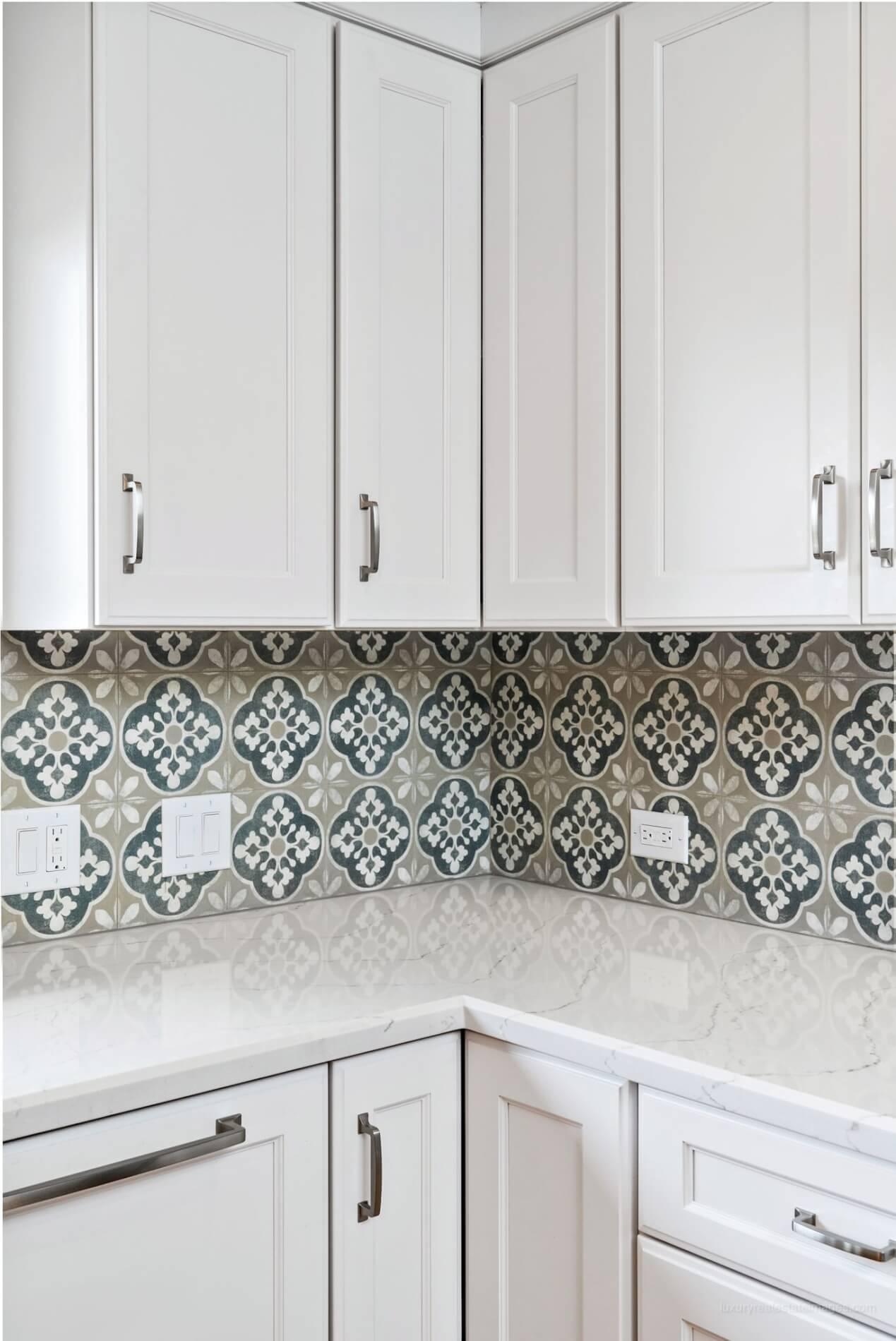 simple white kitchen with patterned backsplash