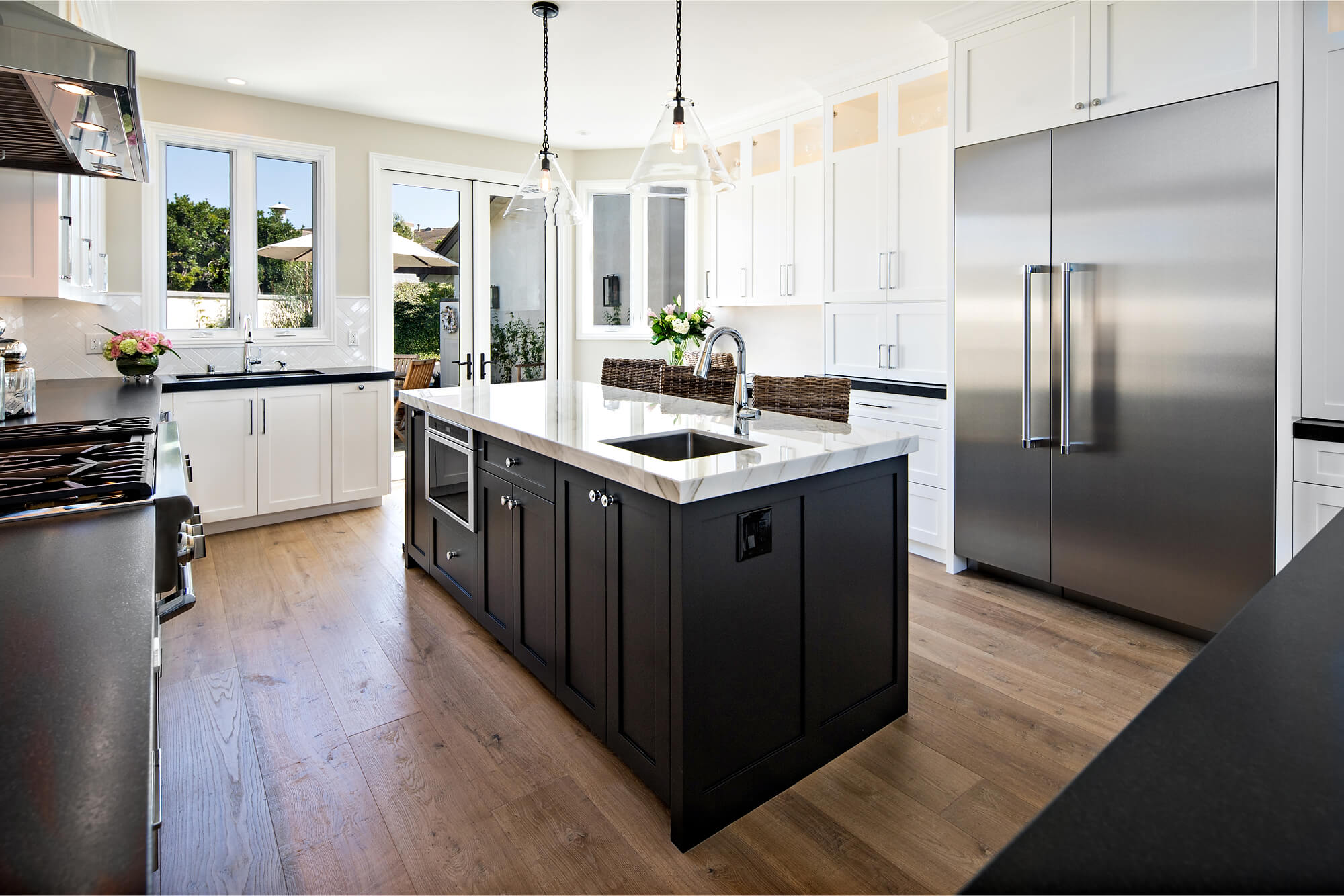 large black and white kitchen with island work space