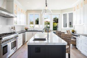 white kitchen with dark island cabinets