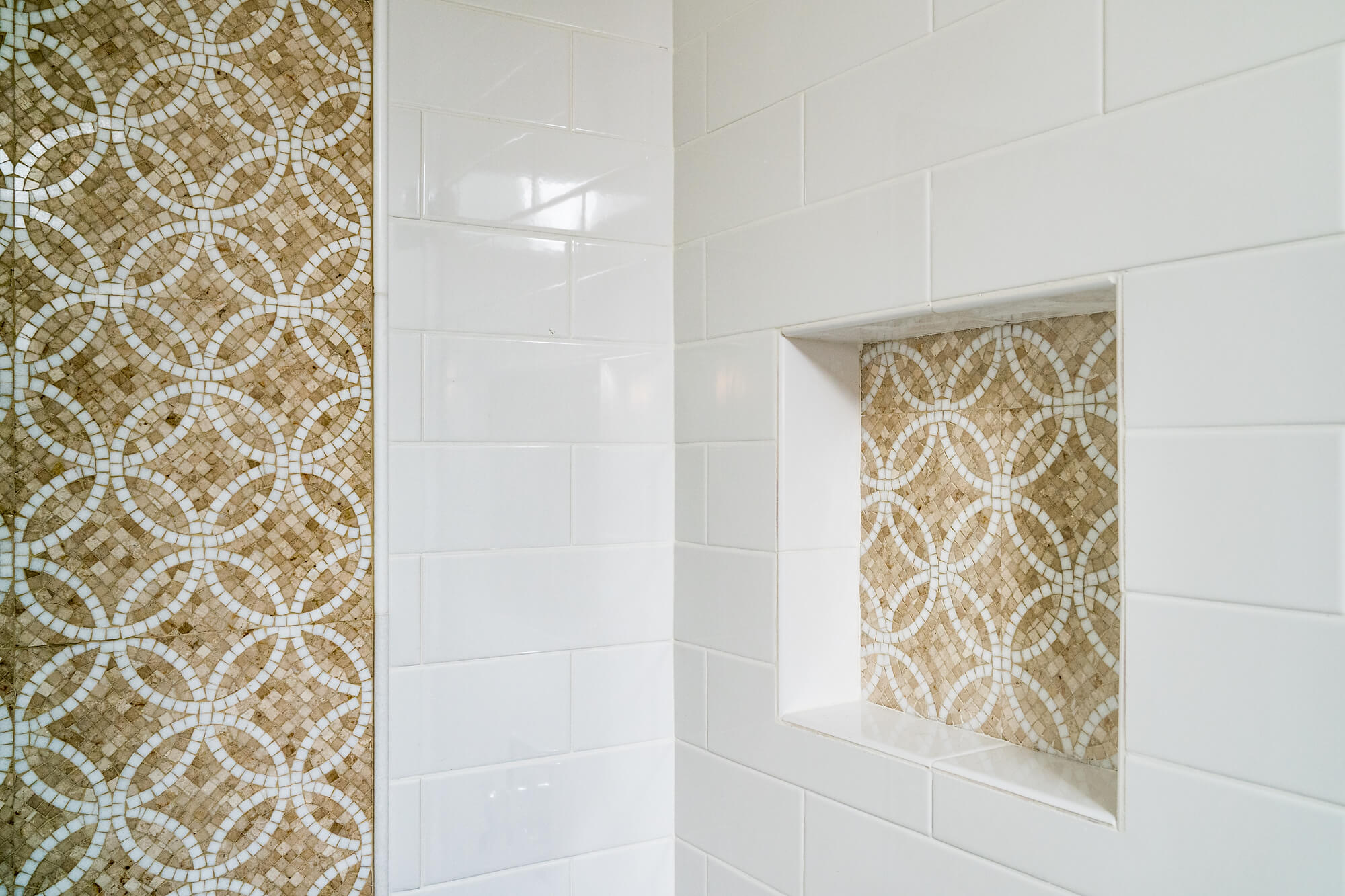 tile mosaic details in creme and white shower