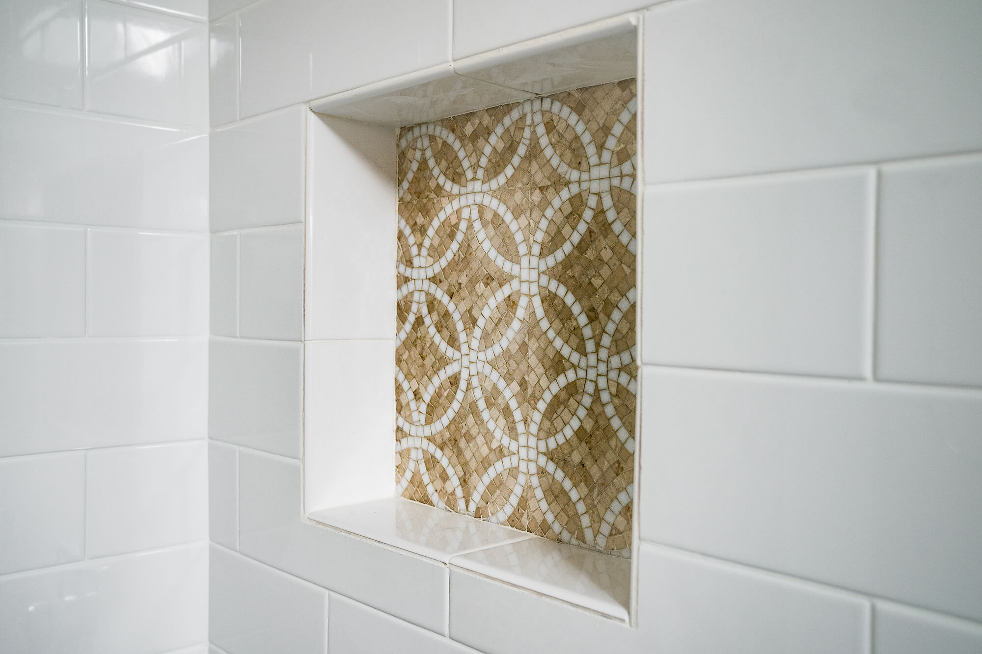 white and creme shampoo box in shower