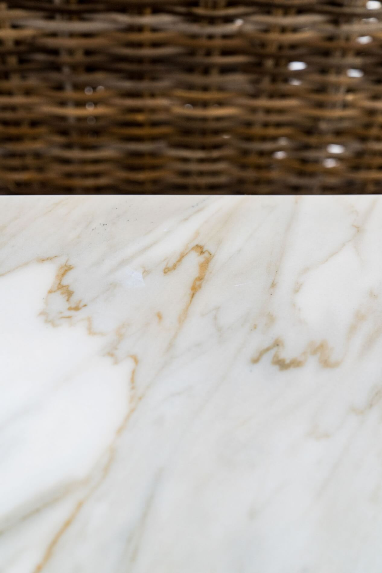 white countertop with gold brown veining