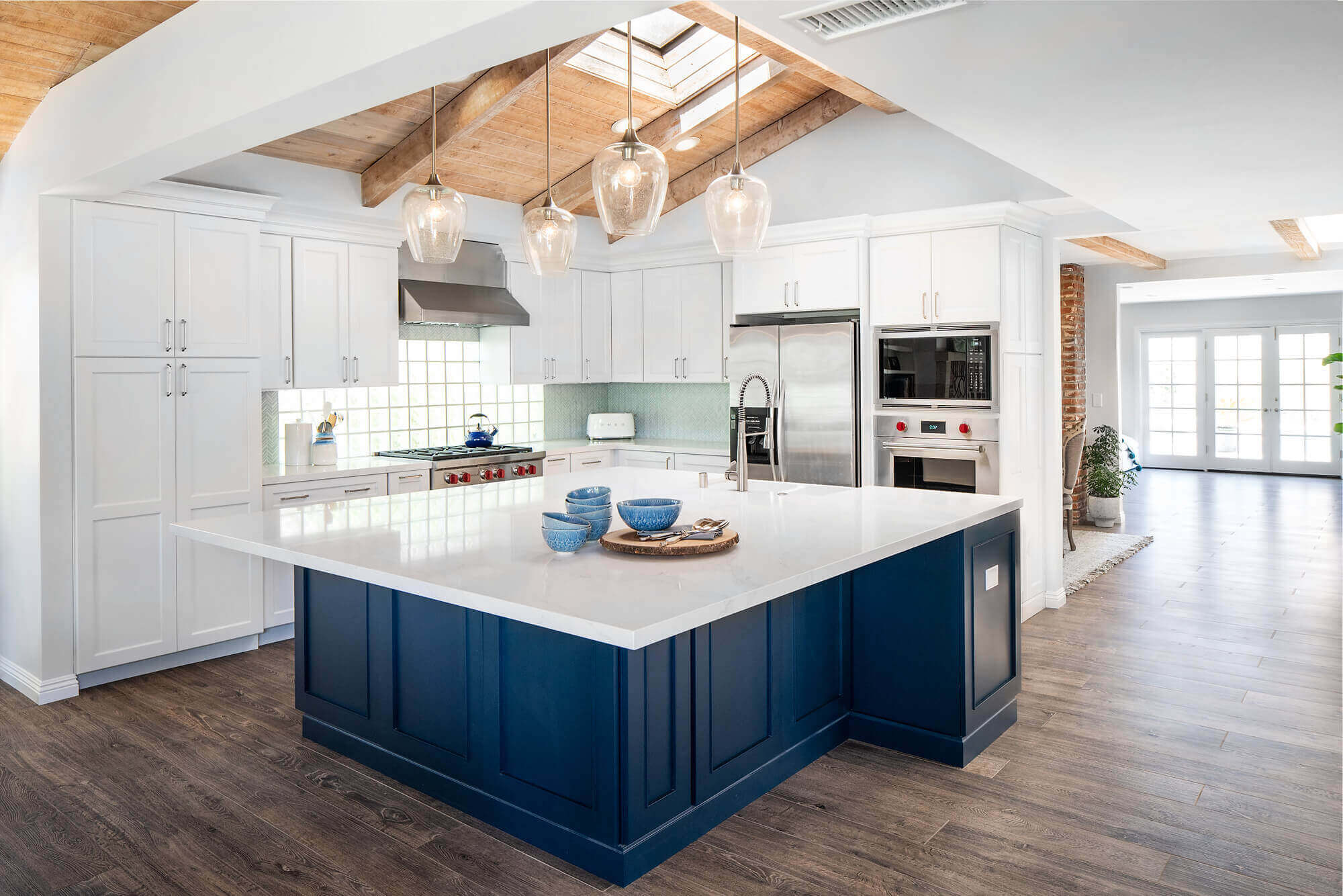 remodeled kitchen with classic blue island and quartz countertops.