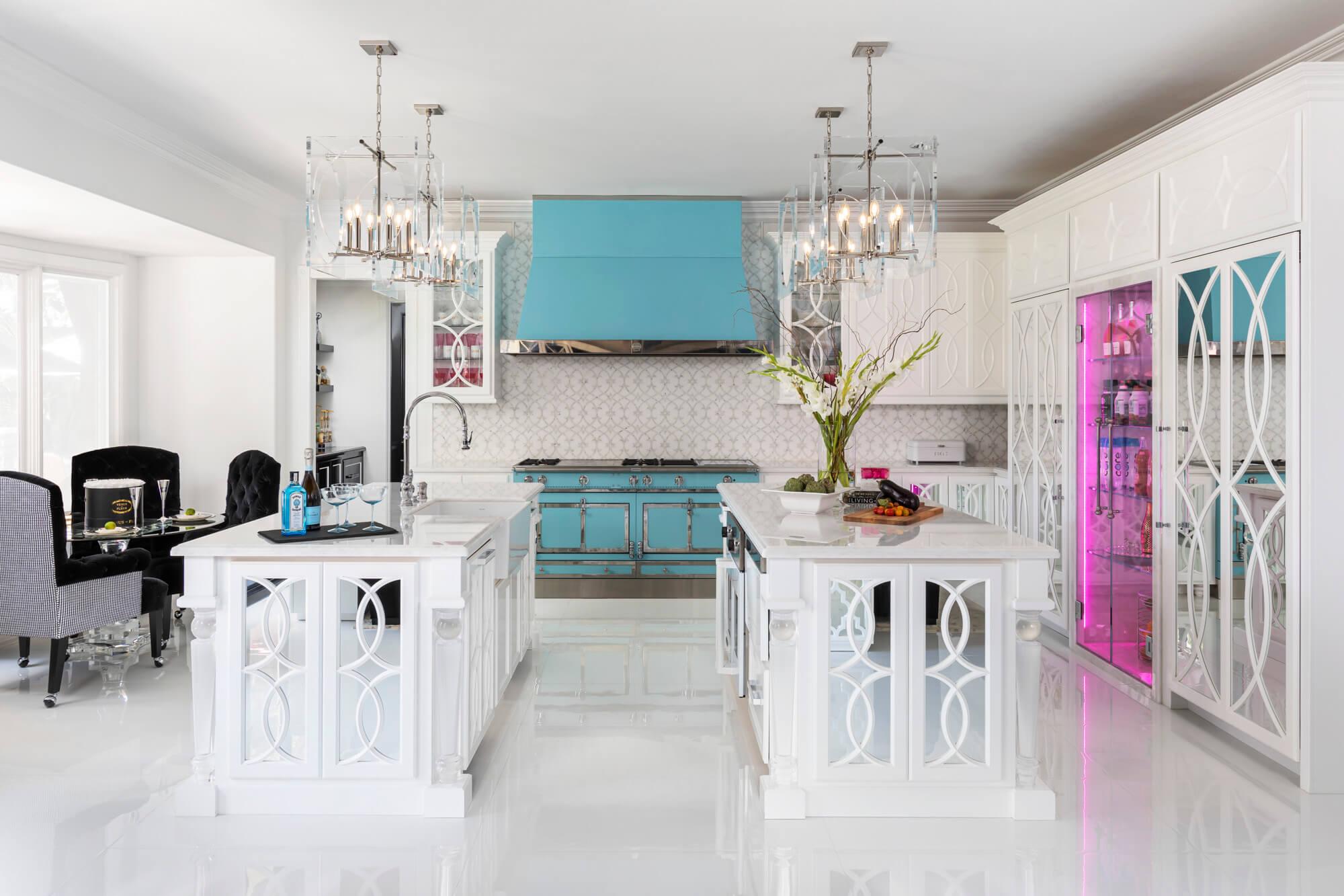 Pink custom beverage center in luxury kitchen remodel.