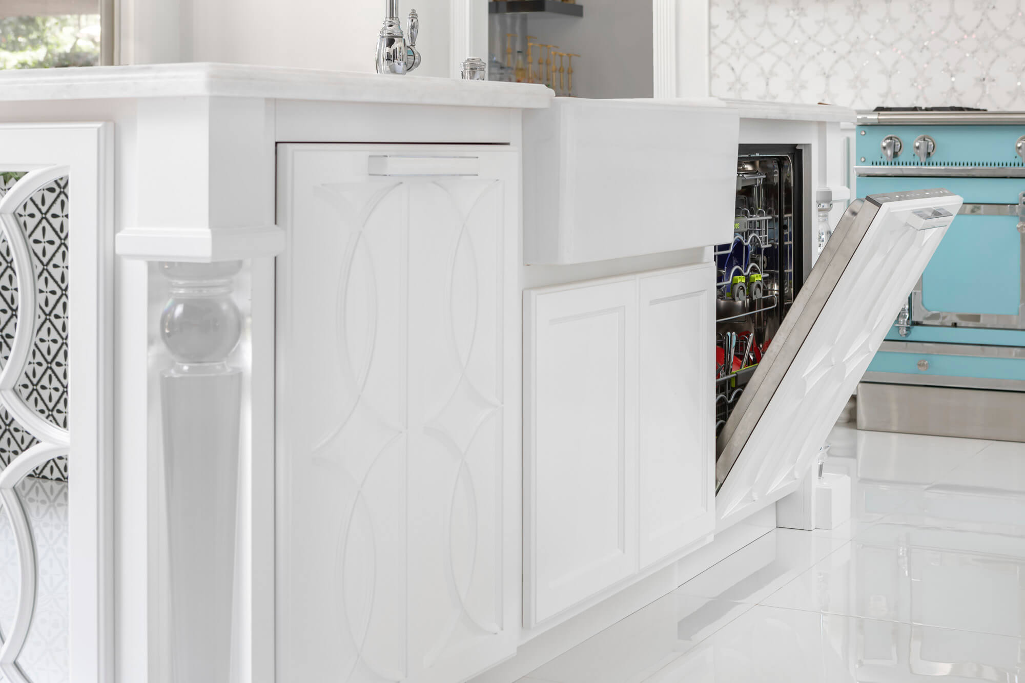 Custom cabinets using luxury design to disguise dishwasher.