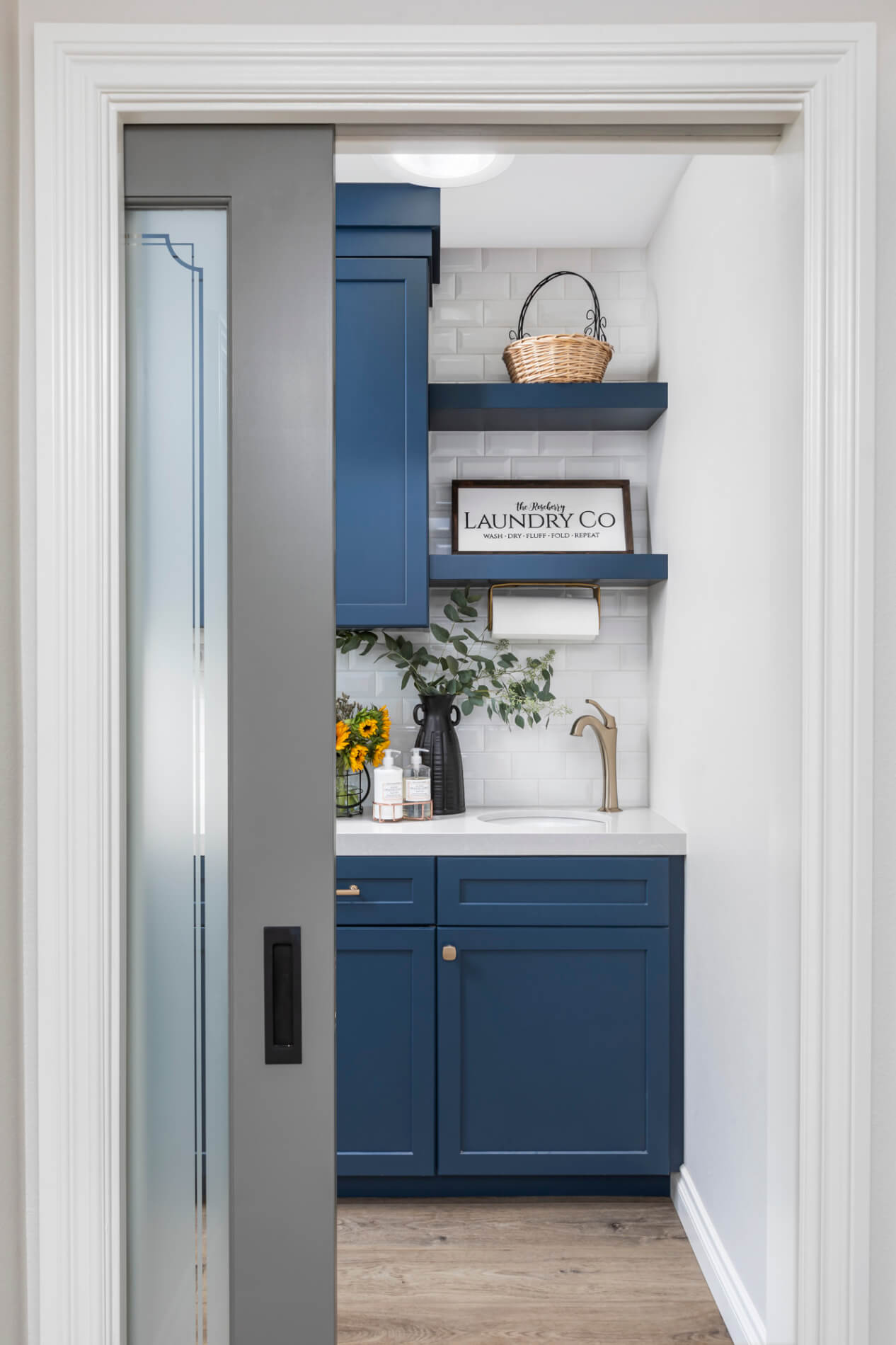 Tustin laundry room with pocket door to maximize space