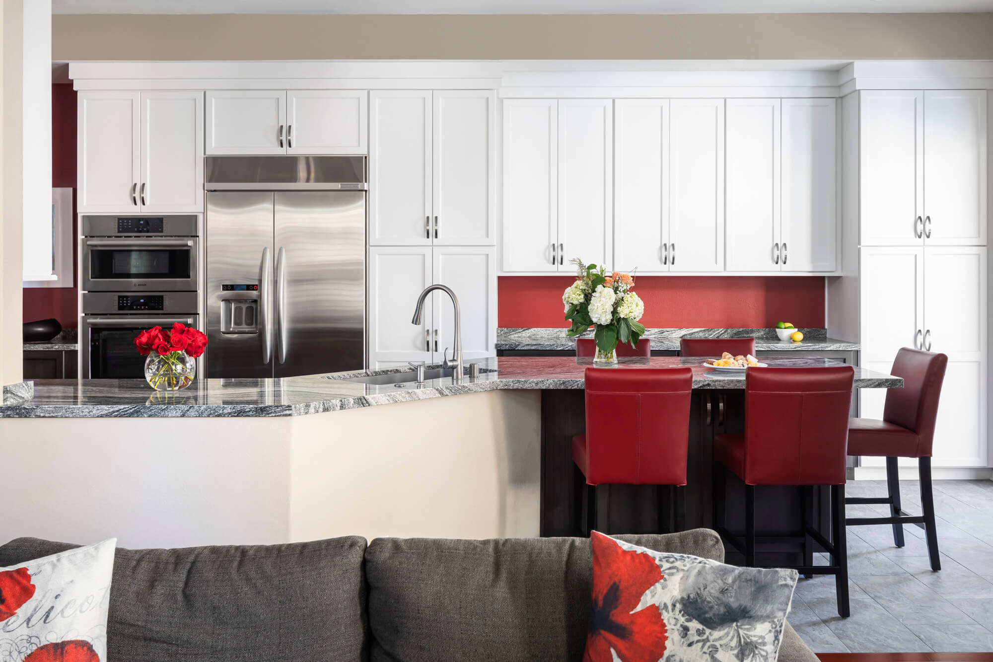 White contemporary styled kitchen with marble countertops