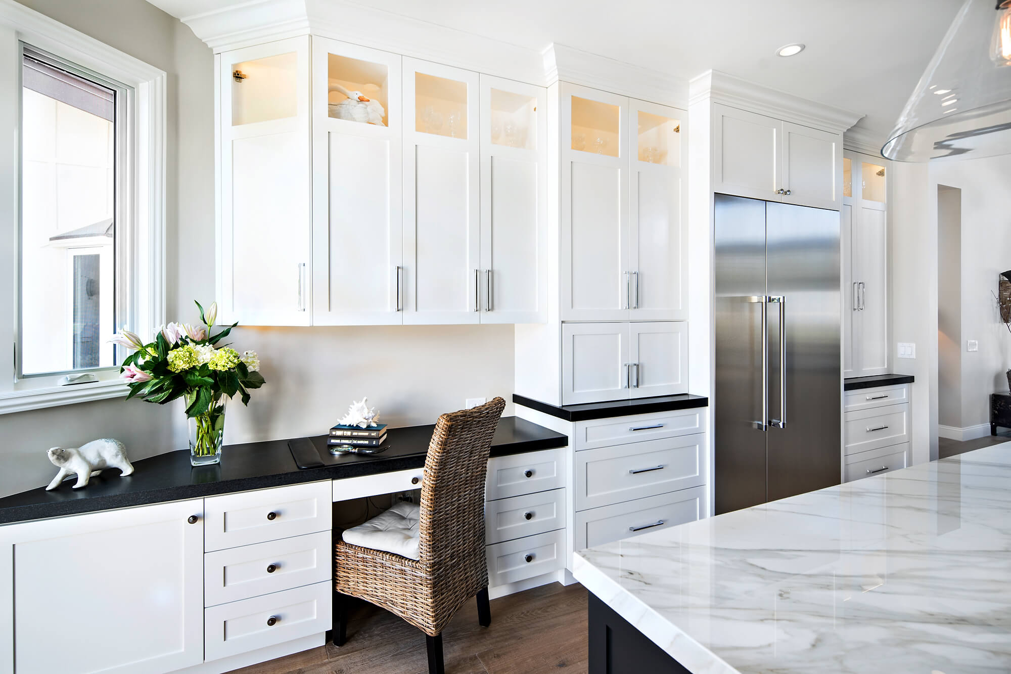 Remodeling in place has increased demand for desks in kitchens.